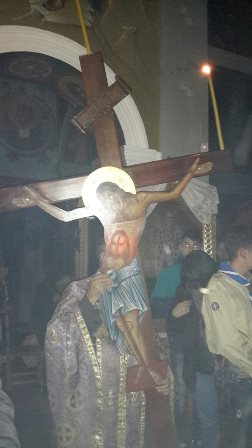 Christ on the cross carried in to the church