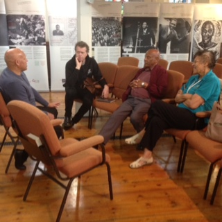 Australian journalist Jeff Sparrow (2nd from left) sharing Paul Robeson stories with Members of the Paul Robeson Wales Trust - Ian Ernest, Harry Ernest and Lesley Clarke last Monday.